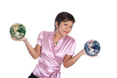 Asian businesswoman with two world in hand Stock Photography