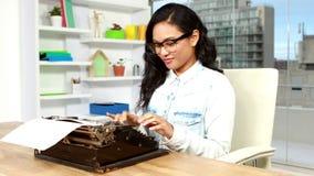 Asian businesswoman typing on typewriter stock video footage