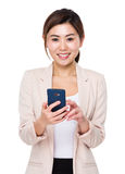Asian businesswoman use of the cellphone Royalty Free Stock Photography