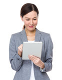 Asian businesswoman use of digital tablet Royalty Free Stock Images
