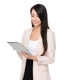 Asian businesswoman use of digital tablet Stock Image