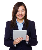 Asian businesswoman use of digital tablet Royalty Free Stock Photo