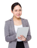 Asian businesswoman use of digital tablet Royalty Free Stock Photos