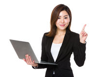 Asian businesswoman use of laptop and finger point up Stock Photography