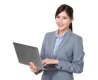 Asian businesswoman use of laptop Royalty Free Stock Image