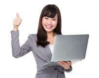 Asian businesswoman use of laptop and thumb up Stock Photo