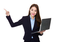 Asian businesswoman use of notebook computer and finger point up Royalty Free Stock Photo