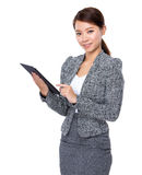 Asian Businesswoman use of tablet Royalty Free Stock Image
