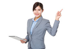 Asian businesswoman use of tablet and finger point up Stock Photography