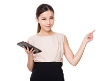 Asian Businesswoman use of tablet and finger point up Royalty Free Stock Image