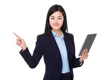 Asian businesswoman use of tablet and finger pointing up Royalty Free Stock Image