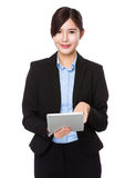 Asian businesswoman use of the tablet pc Stock Photography