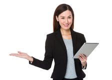 Asian Businesswoman use of the tablet pc and open hand palm Royalty Free Stock Image