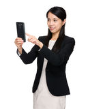Asian businesswoman using the cellphone for taking photo Royalty Free Stock Photos