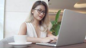 Asian businesswoman using computer