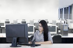 Asian businesswoman using a computer in the office stock photography