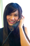 Asian businesswoman using telephone Stock Image