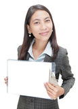 Asian businesswoman w copyspace clipboard. Smiling standing young congenial Asian businesswoman holding up an empty clipboard with pure white copyspace. Focus on Royalty Free Stock Image