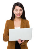 Asian businesswoman watching on the notebook computer Stock Photography