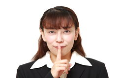 Asian businesswoman whith silence gestures Royalty Free Stock Photos