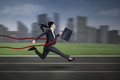 Asian businesswoman winning a race. At business competition royalty free stock image