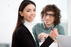 Asian businesswoman working with businessman in Stock Photo