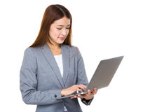 Asian businesswoman working on laptop Stock Photo