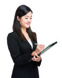 Asian businesswoman write on clipboard Royalty Free Stock Image