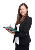 Asian businesswoman write on clipboard Stock Images
