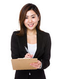 Asian businesswoman write on clipboard. Isolated on white background Royalty Free Stock Images