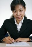 Asian Businesswoman Writing Royalty Free Stock Photos