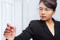Asian businesswoman writing on glass board. Stock Photography