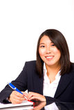 Asian businesswoman writing Royalty Free Stock Image
