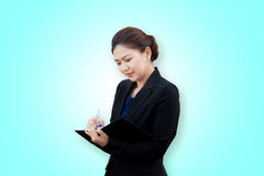 Asian businesswoman writing a note royalty free stock photography