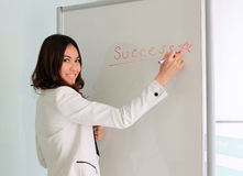 Asian businesswoman writing success in whiteboard royalty free stock image
