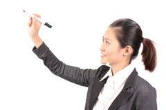 Asian businesswoman writing using marker Royalty Free Stock Image