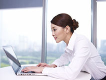 Asian businesswoman. Young asian businesswoman working on laptop in office Stock Image