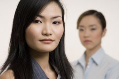 Asian Businesswomen 4. An attractive asian businesswoman with a colleague standing behind (out of focus Stock Photo