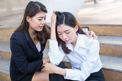 Asian Businesswomen was sick. Colleagues take care. Concern and worry of friend royalty free stock image