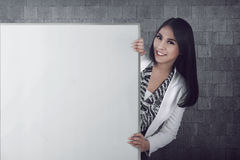 Asian bussiness woman holding blank board Royalty Free Stock Images