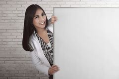 Asian bussiness woman holding blank board Royalty Free Stock Photo