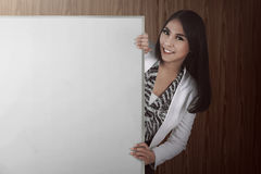 Asian bussiness woman holding white board Royalty Free Stock Image