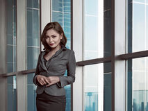 Asian bussineswoman wearing gray suit in office Stock Image