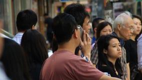 Pedestrians in modern asian city street stock video