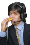 Asian call center agent blowing whistle stock image