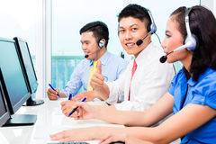 Asian call center agent team on phone Stock Images