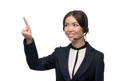 Asian call center female operator pointing at Royalty Free Stock Photos