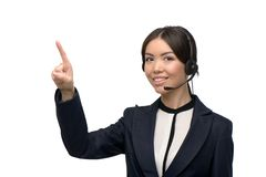 Asian call center female operator pointing at Stock Image