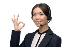 Asian call center female operator showing ok sign Stock Photos