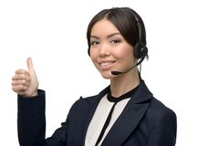 Asian call center female operator showing thumb up Stock Image